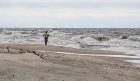 Lonely man on the beach. Amber gathering, stormy weather Stock Photography