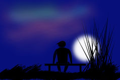 Lonely man on the bench. In the picture is lonely figure during the full moon Stock Photos