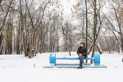 Lonely man on the bench in a winter park Royalty Free Stock Photography