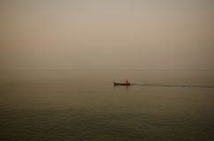 Lonely man. In the boat on the sea,Pattaya,Thailand Royalty Free Stock Photo