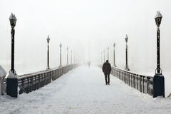 Lonely man on bridge Royalty Free Stock Photography