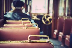 A lonely man is in the car of an old tram.  royalty free stock photos