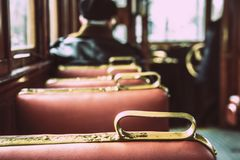 A lonely man is in the car of an old tram.  stock images