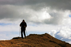 Lonely man in Ciucas mountains, Romania royalty free stock photography