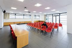 Lonely man in empty conference room, concept royalty free stock photography