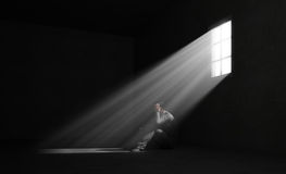 Lonely man in a dark room Stock Images