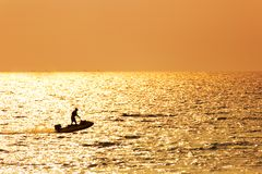 The lonely man drive jet ski in the sea water. royalty free stock image