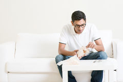 Lonely man eating food alone at home Stock Photo
