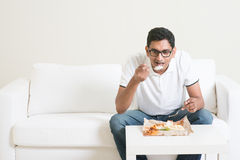 Lonely man eating food Royalty Free Stock Image