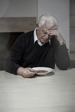 Lonely man eating soup Royalty Free Stock Image
