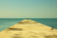 A lonely man on a empty pier Royalty Free Stock Image