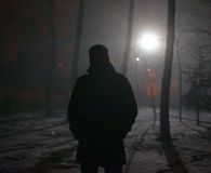 Lonely man in the fog at night Stock Photography