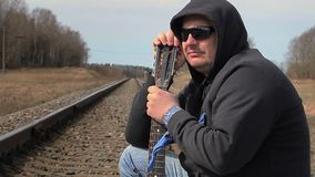 Lonely Man with guitar on the railway stock video