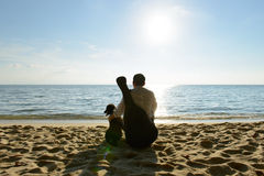 Lonely man with dog and guitar. Lonely man with his dog and guitar at beach Stock Photo