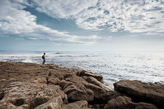Lonely Man Looking at Sea Stock Photos
