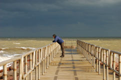 Lonely man on the pier Royalty Free Stock Photos