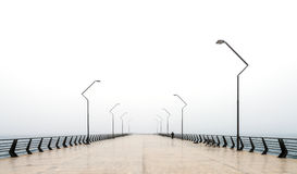 Lonely man on pier Stock Photography