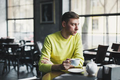 Lonely man relaxing in a cafe Royalty Free Stock Photography