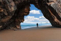 Lonely man at the rocky arch royalty free stock images