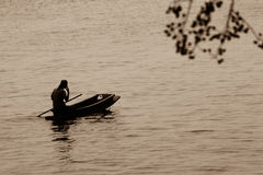 Man in rowboat at sea Royalty Free Stock Photography