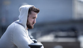 Lonely man with sad look. And hood Stock Photography