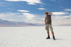 Lonely man on salt desert. Death Valley. USA. royalty free stock images