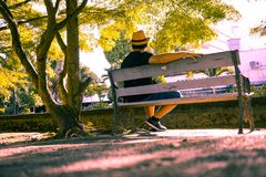 The lonely man sit on the chair. In the park Royalty Free Stock Image