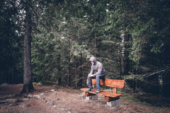 Lonely man sitting on bench Stock Photography