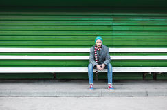 Lonely man sitting on a bench Stock Image