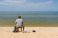 Lonely man sitting by the Dnepr river Royalty Free Stock Photo