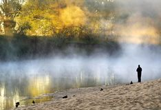 Lonely Man Standing Soul Searching On Bank Foggy Misty River Royalty Free Stock Photography