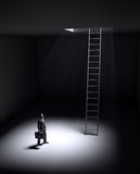 A lonely man standing in a spot of light Stock Images