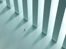 A lonely man walk the corridor with columns to the light 3D rendering Stock Photo