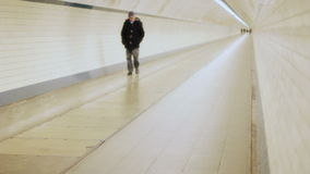 Lonely Man Walking head down in a Tunnel in Slow Motion stock footage