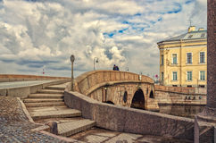A lonely man walking over Prachechny bridge at a cloudy spring day. Royalty Free Stock Image