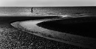 Lonely man walking at seaside Stock Photo