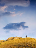 Lonely man walking toward mountain Royalty Free Stock Photos
