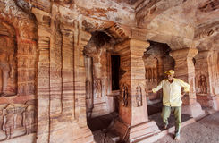 Lonely man watching reliefs inside the 6th century Hindu temple with carved columns of ancient Karnataka Royalty Free Stock Photography