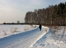 Lonely man on winter road Stock Photo