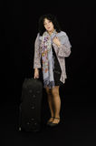 Lonely mature woman standing with black suitcase Royalty Free Stock Photo