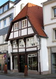 A lonely medieval timber framing house between modern houses. Osnabrück Stock Photo