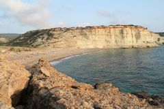 Small beach between the white sea-cliffs stock photography