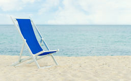 Lonely metal-framed deckchair Stock Photo
