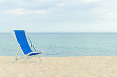Lonely metal-framed deckchair Stock Photography