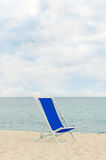 Lonely metal-framed deckchair Stock Images