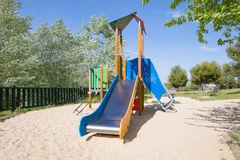 Lonely metal slide in playground Stock Photography