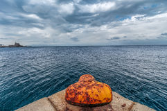 Lonely mooring post Stock Photography