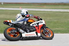 Lonely motorbike racer in the left turn on the track. Blurred background stock photo