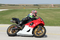 Lonely motorbike racer in the left turn on the track. Blurred background royalty free stock images