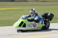 Lonely motorbike sidecar in the left turn on the track. stock photography